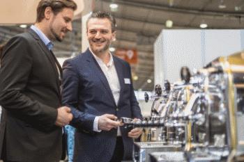 intergastra two men observing coffe machine